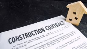 Construction contract and house. concept of real estate and planning of building a house. project home. investing in new buildings. Selective focus stock images