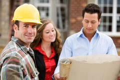 Construction: Contractor with Agents Behind Royalty Free Stock Photography