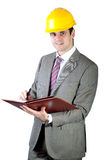 Construction Contractor Businessman. On white background, smiling, taking note and looking at camera Royalty Free Stock Image