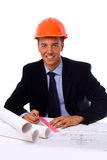 Construction contractor in the office. On his laptop. Isolated on white stock image
