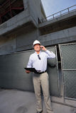 Construction contractor on the phone at the site Royalty Free Stock Photo