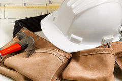 Construction contractor tools with blue print drawings in backgr Stock Photo