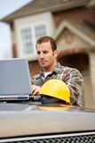 Construction: Contractor Using Laptop for Work stock photography