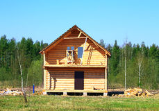 Construction of cottage on the edge of the forest Royalty Free Stock Images