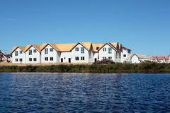 Construction of cottages on the lake Royalty Free Stock Image