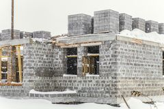 Construction of a country house stopped for the winter stock photography