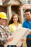 Construction: Couple Reviewing Blueprints stock image