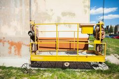Construction cradle on the background of the wall. Of the house royalty free stock image