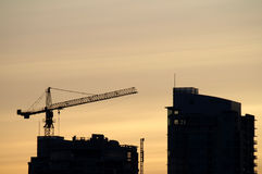 Construction crane. Building a high rise at dusk Royalty Free Stock Photos