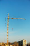 Construction crane. At building site at blue sky Royalty Free Stock Image