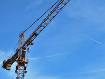 Construction crane. View of a high-rise construction crane on sky Royalty Free Stock Photos