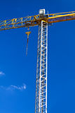 Construction Crane. Against a blue sky with cloud background Royalty Free Stock Photo