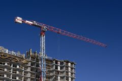 Construction with crane. Construction of the new elite house Stock Photos