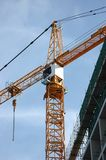 CONSTRUCTION CRANE. Frame-body over blue sky background Stock Photography