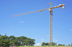 Construction crane. Picture of a high construction crane Stock Photos