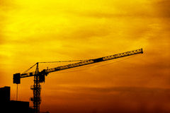 Construction crane. Crane use in construction site in silhouette style Royalty Free Stock Photos
