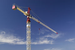 Construction Crane. With a great day-time sky, and no identifying markings, names or advertising Royalty Free Stock Images