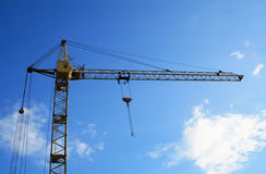 Construction crane. Photo of construction crane with blue sky background Royalty Free Stock Image