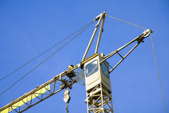Construction Crane. A view of the cabin of a heavy-duty crane at a construction site Royalty Free Stock Image
