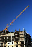Construction crane. Build a new residential house Royalty Free Stock Images