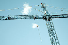 Construction crane. Against blue sky Royalty Free Stock Image