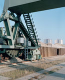 Construction Crane. A crane with sand and gravel in the backround Stock Photos