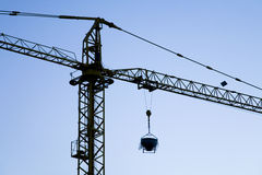 Construction crane. In semi-silhouette Stock Photos