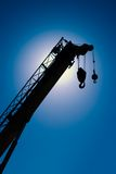 Construction Crane. Silhouette against blue sky Stock Photos