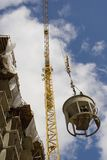 Construction crane in action Royalty Free Stock Image