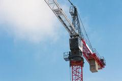Construction crane against the blue sky Stock Images
