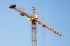 Construction crane against blue sky. Construction crane against blue sky Royalty Free Stock Photos