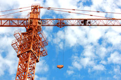 Construction crane against the blue sky Royalty Free Stock Images