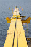 Construction crane against the blue sky, Crane for support heavy lift in offshore oil and gas industry. Stock Image