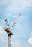 Construction crane against cloudy sky Stock Photography