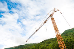 Construction crane in alps Royalty Free Stock Photos