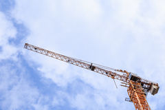 Construction crane from an ant eye view. Construction crane, blue sky, and white cloud from an ant eye view Stock Image