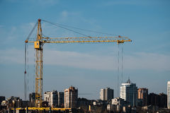 Construction crane and Assembly of the structure of the building object on the background of the city Royalty Free Stock Image
