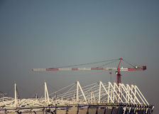 Construction crane and Assembly of the structure of the building object Royalty Free Stock Photo