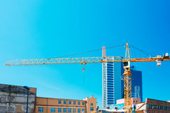 Construction Crane On Background Of New Modern Skyscraper And Ol Stock Photography