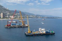 Construction crane barges. A construction crane barges begins land reclamation work off the coast of Monaco royalty free stock photo