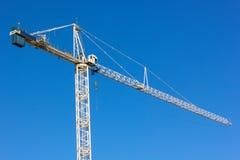 Construction crane. Blue construction crane against a clear sky Stock Photo