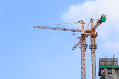 Construction crane. And blue sky Royalty Free Stock Image