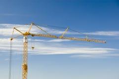 Construction crane on blue sky Stock Image