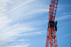Construction crane with blue sky. In the background Stock Photography