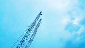 The construction crane on blue sky background, beautiful view landscape. Wallpaper design stock images