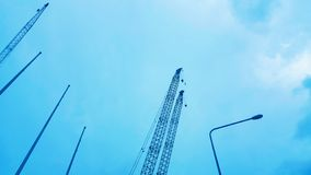 The construction crane on blue sky background, beautiful view landscape. Wallpaper design royalty free stock photos