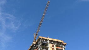 Construction crane blue sky building urban house. City development moving crane background low angle shot stock footage