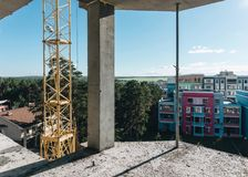 Residential buildings cunstruction place with a cunstruction crane. Royalty Free Stock Photos
