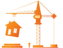 Construction crane and building. Construction equipment - crane and new house Royalty Free Stock Photography