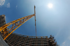 Construction crane and building Stock Photos